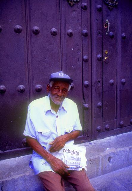 Man selling Communist Daily Newspaper, Havana