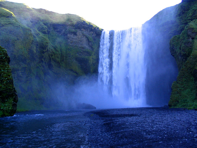 Iceland's thundering Skogafoss Falls are 200' high. I camped near here.