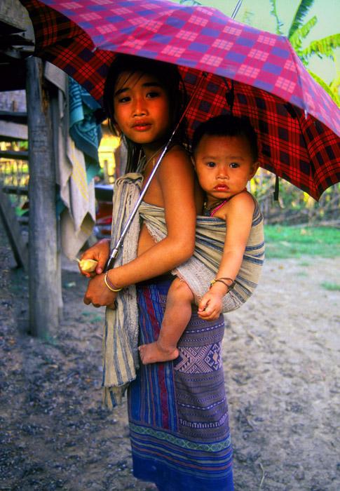 Sister carrying brother, Muang Kham, Laos