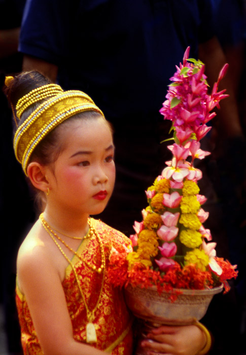 Girl carrying flowers to temple, Luang Prabang, Laos