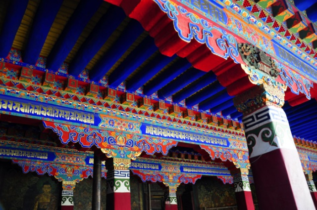 Tibet, colorful roof beams at the Jokhang Temple, Lhasa.