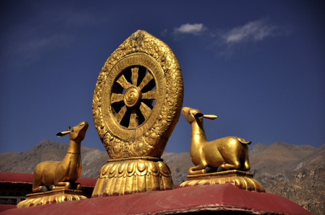 The symbol of Tibet - two dear worshipping a Dharma Wheel, atop the Jokhang Temple, Lhasa.