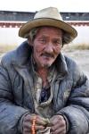 Tibet - beggar near Tashilhunpo Kora, Shigatse