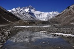 Tibet - Mt Everest's north face reflectied in an icy pond near the North Base Camp.