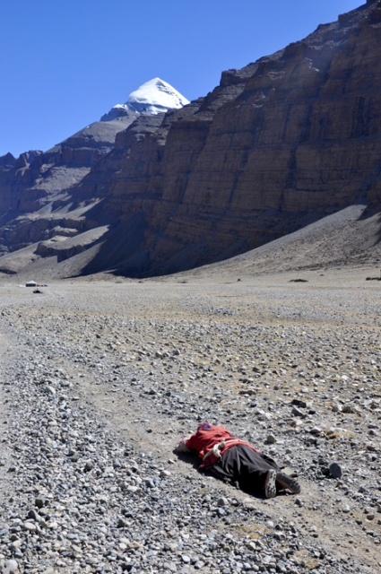 Prostrating pilgrim on the Mt Kailash kora, western Tibet