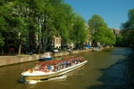 Tour boat on canal, Amsterdam, Netherlands