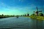 Widmills at Kinderdijk and canal boat, Netherlands